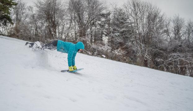 Mature woman snow sledding