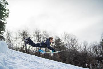 Little Dare Devil jumping ramp snow sledding