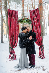 Wedding ceremony for two near the red arch