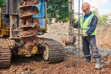 boring holes in ground by drilling rig machine