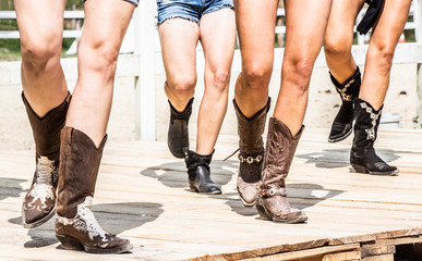 Cowgirl girls legs in boots dancing