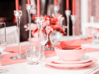 Beautiful table setting in Living Coral color. Living coral is color of the Year 2019. Shallow DOF