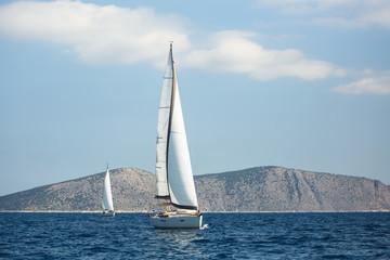 Sailing luxury yacht boats in regatta, Aegean Sea, Greece.