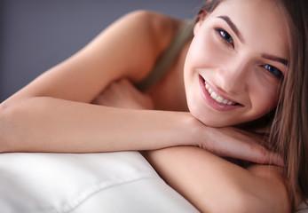 Beautiful young woman lying on the sofa