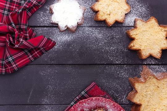 Italian Pandoro Christmas Cake with Lemon Cream. Decor and sweets for Christmas. Winter holiday. Top view.