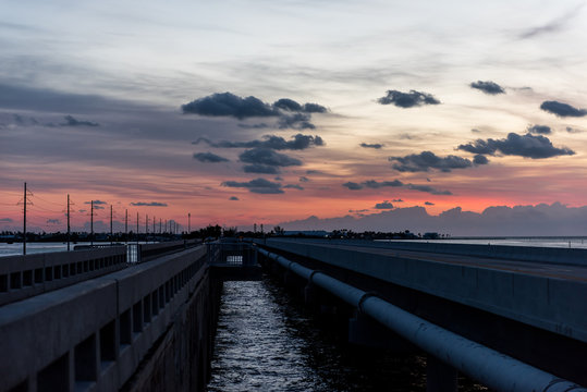 Sunrise in Islamorada, Florida Keys, with red blue sky, overseas highway road, village of islands, in Atlantic Ocean, gulf of Mexico, horizon