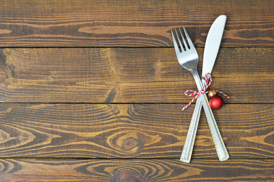 Christmas silverware on rustic wooden table