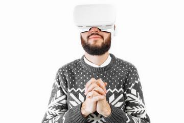 man Christmas in 3D glasses, virtual reality glasses, man praying