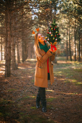 Happy Blonde Woman and Christmas Tree