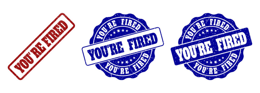 YOU'RE FIRED grunge stamp seals in red and blue colors. Vector YOU'RE FIRED signs with scratced effect. Graphic elements are rounded rectangles, rosettes, circles and text captions.