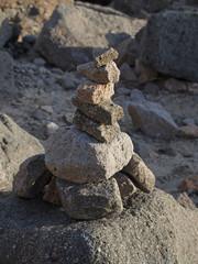 stack of stones (cairn) at Morro Rock, California, USA
