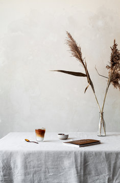 Still with pampas grass, coffee and book