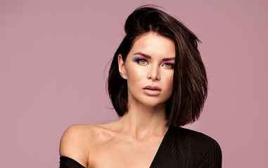 Sensual woman with colorful makeup.