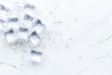 Frozen water in ice cubes on marble bar table top view mockup