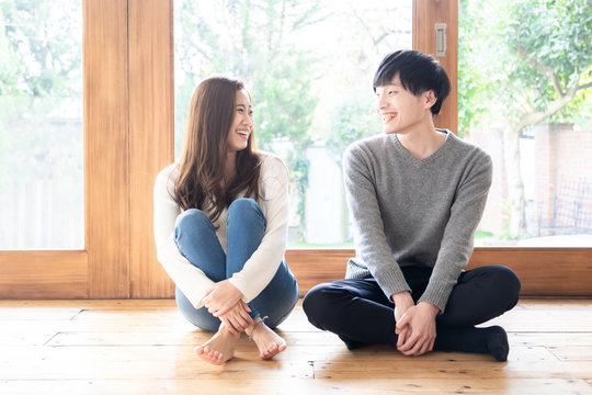 young asian couple relaxing in living room