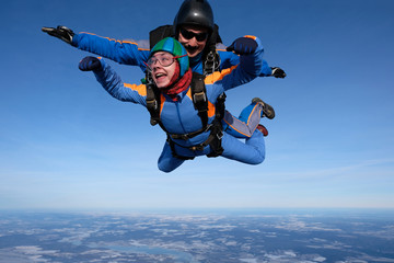 Skydiving. Tandem jump with happy girl.