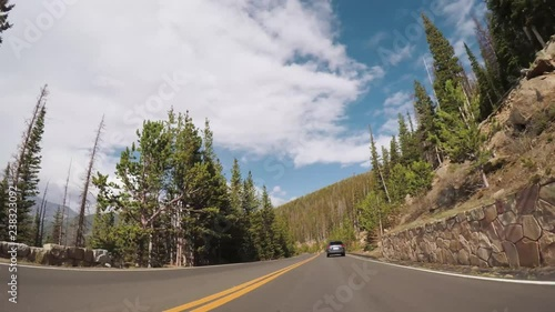 Wall mural Driving on paved road in Rocky Mountain National Park.