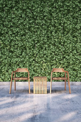 Wooden chair on bare concrete floor with plant wall background.3D illustrator