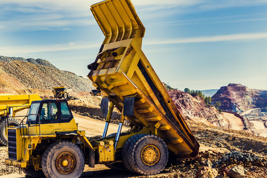Yellow dump truck lifted in the mine