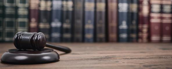 Fototapeta Judge Gavel and Law books on a  wooden background. obraz