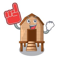 Foam finger chicken in a wooden cartoon coop