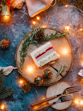 Red Christmas cake, on a blue background with garland and red balls