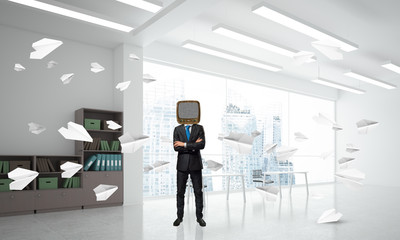 Businessman with an old TV instead of head.
