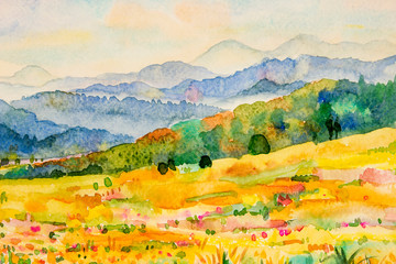 Watercolor landscape painting of mountain and meadow.
