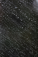 heavy rain falling on window surface