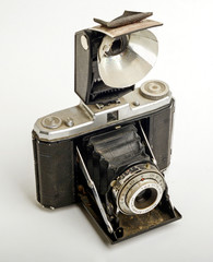 Vintage collapsible camera with foldable flash