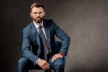 successful businessman sitting in glasses and suit