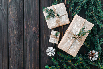 Christmas fir tree with decoration on a wooden board. Copy space for text Wall mural