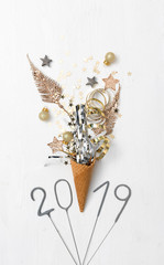 new year background with ice cream cone and items on white background