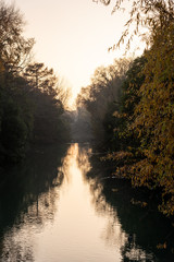 Autumn sunset during the navigation of a small river