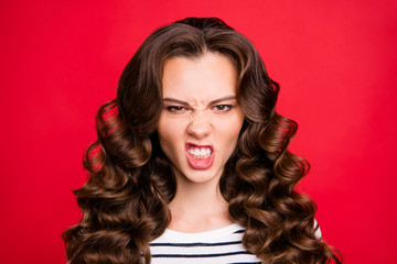 Close up portrait of attractive perfect hairstyle she her girl grin mad crazy in anger stay away from me look white striped pullover isolated on red vivid background