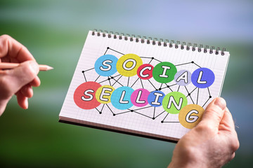 Social selling concept on a notepad