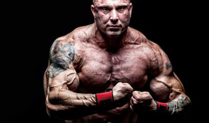 Muscular Man on Black Background