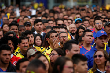 Colombian fans watch the broadcast of the World Cup Round of 16 soccer match between Colombia and England in Bogota