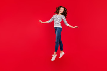 Full length size body photo of jumping high pretty charming she her girl look like has wings  wearing white casual sweater on red vivid bright background