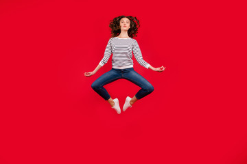 Full length size body photo of fly high pretty charming she her girl getting yoga energy in lotus pose wearing striped white casual sweater on red vivid bright background
