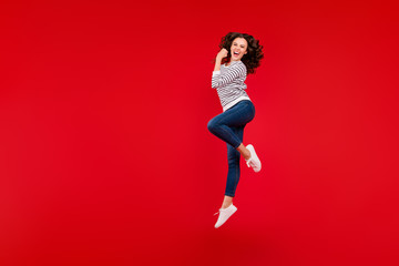 Full length size body photo of fly high attractive beautiful her girl won competitions gladly raised one arm wearing white casual striped sweater on red vivid bright background