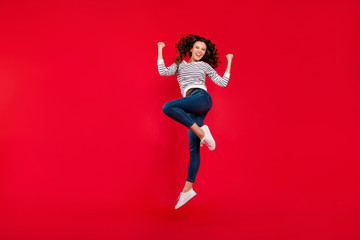 Full length size body photo of fly high attractive beautiful her girl jumping of gladness about score goal in football soccer  wearing striped white casual sweater on red bright background
