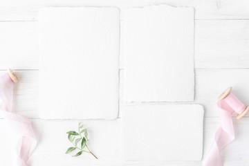 Feminine wedding, birthday desktop mock-up. Invitation card mockup, template Blank greeting cards, rspv card, 5x7, square card, envelope. Silk ribbons, pink, greenery. White wooden background. Flat