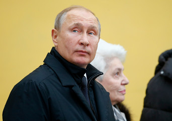 Russian President Putin takes part in a ceremony to unveil a monument to Soviet-era dissident Solzhenitsyn in Moscow