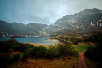 Small lake near green mountains
