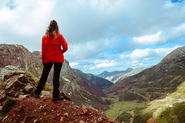 Anonymous female admiring view of mountain ridge