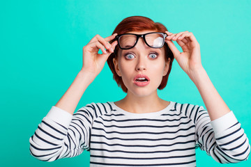 Oh no! Close up head shot photo portrait of confused speechless shocked pretty cute with big eyes she her people person look see watch at you camera adjust touch specs isolated vivid background