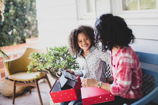 African American mother giving daughter a christmas gift