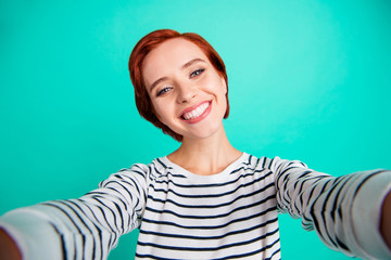 Headshot close up photo portrait of cheerful excited satisfied gorgeous pretty beautiful attractive charming she her girl take make picture on gadget isolated teal pastel background