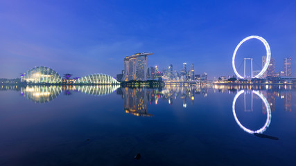 Singapore, 30 Oct 2018: a sunrise skyline view of the Marina Bay with the Garden domes, the Marina Bay Sands hotel and the Flyer Wheel in Singapore.
